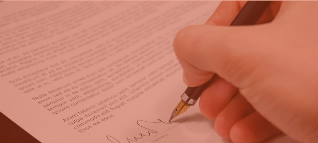 A solicitor signing documents